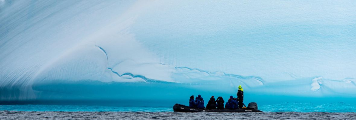 Zodiacs bring us close to the massive icebergs